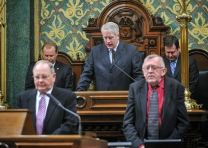 At the Speaker's rostrum offering the invocation