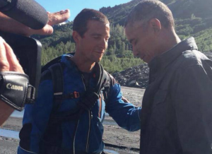 Bear Grylls praying over Barak Obama